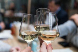Clinking White Wine Glasses